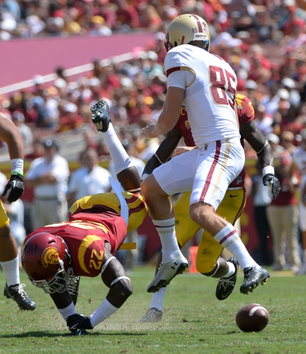 Sep 14, 2013; Los Angeles, CA, USA; USC Trojans safety Leon McQuay III (22) blocks a punt by Boston College Eagles kicke