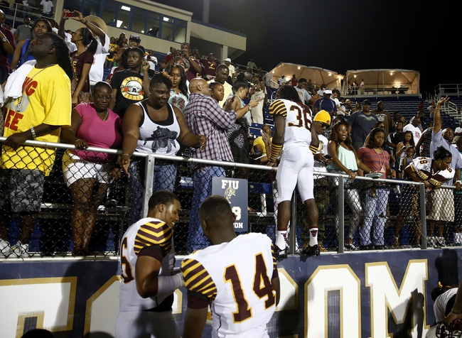 Sep 14, 2013; Miami, FL, USA;  Bethune Cookman Wildcats defensive back Marquis Drayton (36) celebrates with fans after the Wildcats defeated Florida International Panthers 34-13 at FIU Stadium. Mandatory Credit: Robert Mayer-USA TODAY Sports