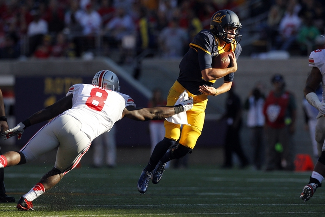 Sep 14, 2013; Berkeley, CA, USA; California Golden Bears quarterback Jared Goff (16) tries to avoid being tackled by Ohio State Buckeyes defensive lineman Noah Spence (8) in the second quarter at Memorial Stadium. Mandatory Credit: Cary Edmondson-USA TODAY Sports