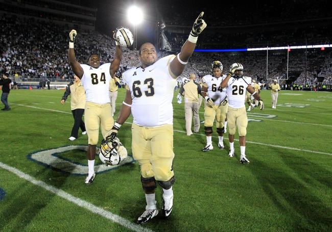 Sep 14, 2013; University Park, PA, USA; Central Florida Knights offensive linesmen Jordan McCray (63) celebrate following the completion of the game against the Penn State Nittany Lions at Beaver Stadium. Central Florida defeated Penn State 34-31. Mandatory Credit: Matthew O'Haren-USA TODAY Sports