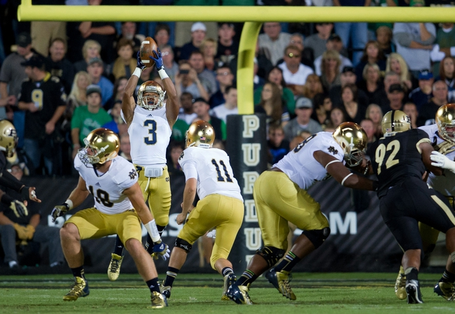 Sep 14, 2013; West Lafayette, IN, USA; Notre Dame Fighting Irish running back Amir Carlisle (3) catches an overthrown long snap in the first quarter against the Purdue Boilermakers at Ross-Ade Stadium. Mandatory Credit: Matt Cashore-USA TODAY Sports