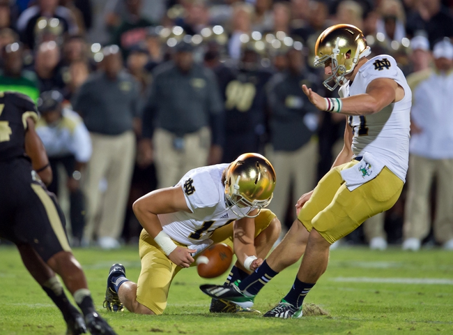 Sep 14, 2013; West Lafayette, IN, USA; Notre Dame Fighting Irish kicker Kyle Brindza (27) kicks a field goal in the second quarter against the Purdue Boilermakers at Ross-Ade Stadium. Mandatory Credit: Matt Cashore-USA TODAY Sports