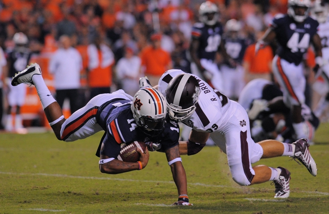 Sep 14, 2013; Auburn, AL, USA; Auburn Tigers quarterback Nick Marshall (14) is brought down by Mississippi State Bulldogs linebacker Richie Brown (39) at Jordan Hare Stadium. Mandatory Credit: Shanna Lockwood-USA TODAY Sports