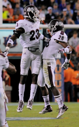 Sep 14, 2013; Auburn, AL, USA; Mississippi State Bulldogs defensive back Taveze Calhoun (23) and Mississippi State Bulldogs defensive back Kendrick Market (26) celebrate an interception during the second half at Jordan Hare Stadium. Mandatory Credit: Shanna Lockwood-USA TODAY Sports