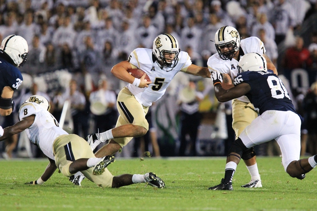 Sep 14, 2013; University Park, PA, USA; Central Florida Knights quarterback Blake Bortles (5) runs the ball during the fourth quarter against the Penn State Nittany Lions at Beaver Stadium. Central Florida defeated Penn State 34-31. Mandatory Credit: Matthew O'Haren-USA TODAY Sports
