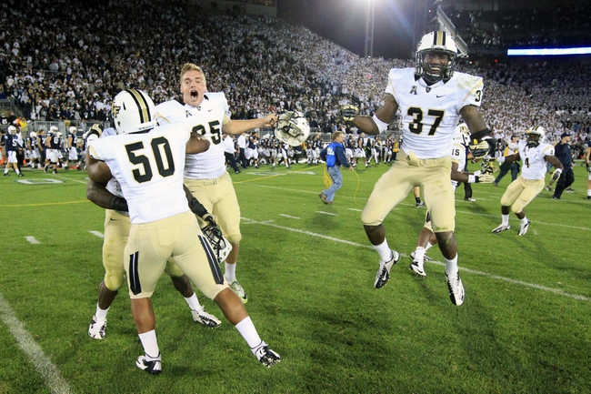 Sep 14, 2013; University Park, PA, USA; Central Florida Knights defensive back Brandon Alexander (37) and teammates celebrate following the completion of the game against the Penn State Nittany Lions at Beaver Stadium. Central Florida defeated Penn State 34-31. Mandatory Credit: Matthew O'Haren-USA TODAY Sports