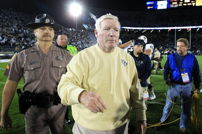 Sep 14, 2013; University Park, PA, USA; Central Florida Knights head coach George O'Leary walks off the field following the completion of the game against the Penn State Nittany Lions at Beaver Stadium. Central Florida defeated Penn State 34-31. Mandatory Credit: Matthew O'Haren-USA TODAY Sports