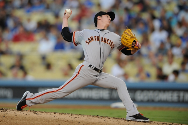 Sep 14, 2013; Los Angeles, CA, USA; San Francisco Giants pitcher Tim Lincecum (55) pitches against the Los Angeles Dodgers during the first inning at Dodger Stadium. Mandatory Credit: Kelvin Kuo-USA TODAY Sports