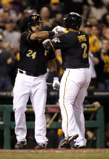 Sep 14, 2013; Pittsburgh, PA, USA; Pittsburgh Pirates third baseman Pedro Alvarez (24) greets right fielder Marlon Byrd (2) at home after Byrd hit a solo home run against the Chicago Cubs during the seventh inning at PNC Park. The Pittsburgh Pirates won 2-1. Mandatory Credit: Charles LeClaire-USA TODAY Sports