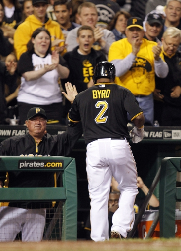 Sep 14, 2013; Pittsburgh, PA, USA; Pittsburgh Pirates manager Clint Hurdle (left) greets right fielder Marlon Byrd (2) at the dugout after Byrd hit a solo home run against the Chicago Cubs during the seventh inning at PNC Park. The Pittsburgh Pirates won 2-1. Mandatory Credit: Charles LeClaire-USA TODAY Sports