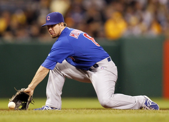 Sep 14, 2013; Pittsburgh, PA, USA; Chicago Cubs third baseman Donnie Murphy (8) fields a ground ball against the Pittsburgh Pirates during the eighth inning at PNC Park. The Pittsburgh Pirates won 2-1. Mandatory Credit: Charles LeClaire-USA TODAY Sports