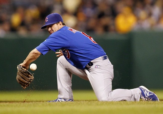 Sep 14, 2013; Pittsburgh, PA, USA; Chicago Cubs third baseman Donnie Murphy (8) attempts to field a ground ball against the Pittsburgh Pirates during the eighth inning at PNC Park. The Pittsburgh Pirates won 2-1. Mandatory Credit: Charles LeClaire-USA TODAY Sports
