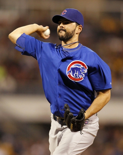 Sep 14, 2013; Pittsburgh, PA, USA; Chicago Cubs relief pitcher Carlos Villanueva (33) pitches against the Pittsburgh Pirates during the eighth inning at PNC Park. The Pittsburgh Pirates won 2-1. Mandatory Credit: Charles LeClaire-USA TODAY Sports