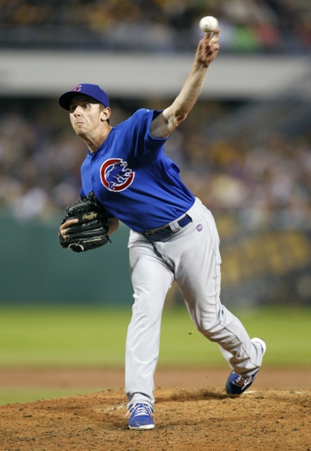 Sep 14, 2013; Pittsburgh, PA, USA; Chicago Cubs relief pitcher Zac Rosscup (59) pitches against the Pittsburgh Pirates during the eighth inning at PNC Park. The Pittsburgh Pirates won 2-1. Mandatory Credit: Charles LeClaire-USA TODAY Sports