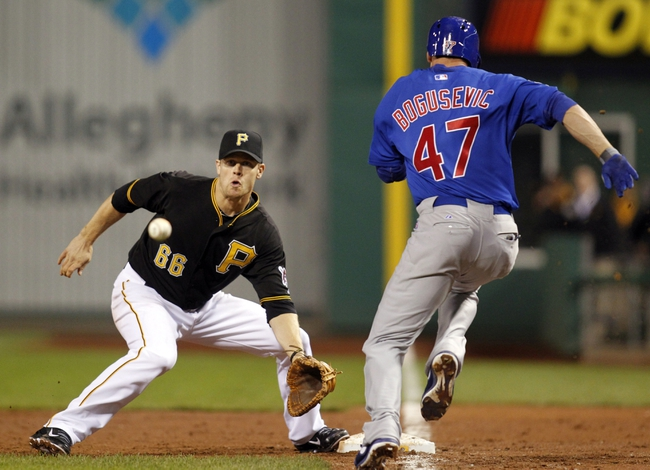 Sep 14, 2013; Pittsburgh, PA, USA; Chicago Cubs right fielder Brian Bogusevic (47) reaches first base on a passed ball after striking out as Pittsburgh Pirates first baseman Justin Morneau (66) waits for the throw during the ninth inning at PNC Park. The Pittsburgh Pirates won 2-1. Mandatory Credit: Charles LeClaire-USA TODAY Sports