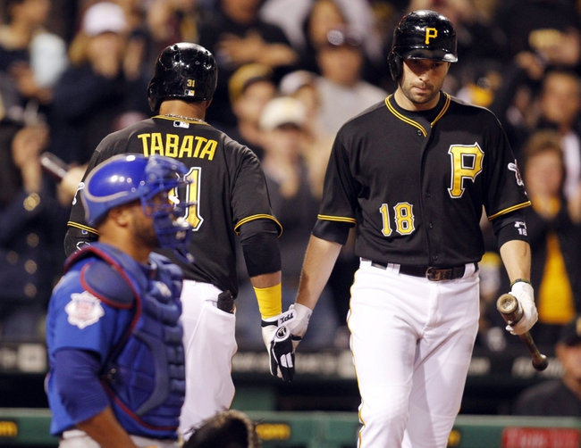 Sep 14, 2013; Pittsburgh, PA, USA; Pittsburgh Pirates second baseman Neil Walker (18) greets Pittsburgh Pirates left fielder Jose Tabata (31) after Tabata hit a solo home ruin against the Chicago Cubs during the sixth inning at PNC Park. The Pittsburgh Pirates won 2-1. Mandatory Credit: Charles LeClaire-USA TODAY Sports