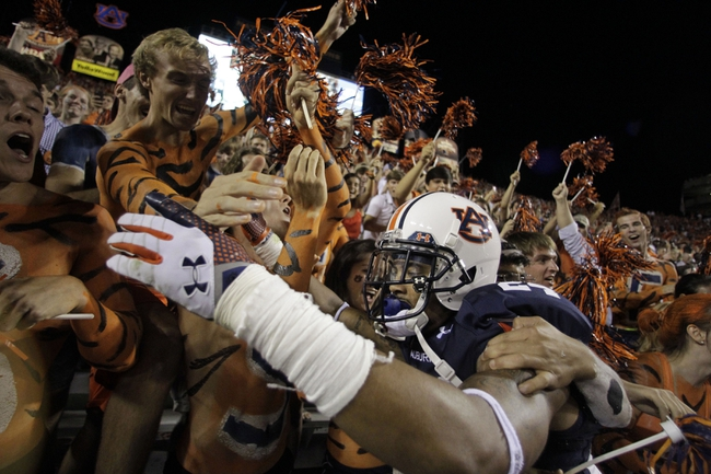 Sep 14, 2013; Auburn, AL, USA; Auburn Tigers defensive back Ryan Smith (24) celebrates with fans after the Tigers beat the Mississippi State Bulldogs at Jordan Hare Stadium. Mandatory Credit: John Reed-USA TODAY Sports