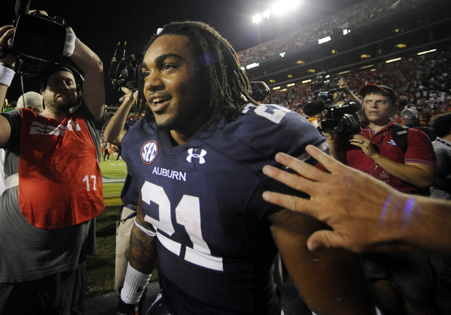 Sep 14, 2013; Auburn, AL, USA; Auburn Tigers running back Tre Mason (21) greets fans after the game against the Mississippi State Bulldogs at Jordan Hare Stadium. The Tigers defeated the Bulldogs 24-20. Mandatory Credit: Shanna Lockwood-USA TODAY Sports
