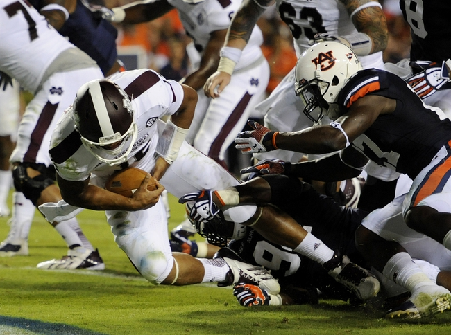Sep 14, 2013; Auburn, AL, USA; Mississippi State Bulldogs quarterback Dak Prescott (15) makes a touchdown against the Auburn Tigers at Jordan Hare Stadium. The Tigers defeated the Bulldogs 24-20.  Mandatory Credit: Shanna Lockwood-USA TODAY Sports