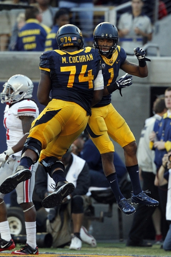 Sep 14, 2013; Berkeley, CA, USA; California Golden Bears wide receiver Bryce Treggs (1) celebrates with offensive lineman Matt Cochran (74) after catching a touchdown pass against the Ohio State Buckeyes in the third quarter at Memorial Stadium. The Buckeyes defeated the Golden Bears 52-34. Mandatory Credit: Cary Edmondson-USA TODAY Sports