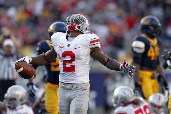 Sep 14, 2013; Berkeley, CA, USA; Ohio State Buckeyes running back Jordan Hall (2) reacts after picking up a first down against the California Golden Bears in the third quarter at Memorial Stadium. The Buckeyes defeated the Golden Bears 52-34. Mandatory Credit: Cary Edmondson-USA TODAY Sports