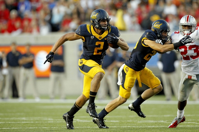 Sep 14, 2013; Berkeley, CA, USA; California Golden Bears running back Daniel Lasco (2) runs with the ball against the Ohio State Buckeyes in the fourth quarter at Memorial Stadium. The Buckeyes defeated the Golden Bears 52-34. Mandatory Credit: Cary Edmondson-USA TODAY Sports