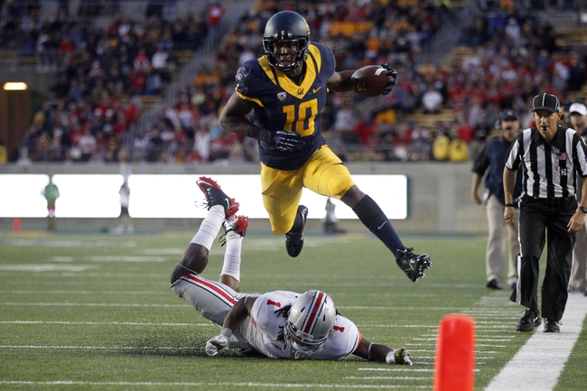 Sep 14, 2013; Berkeley, CA, USA; California Golden Bears wide receiver Darius Powe (10) avoids being tackled Ohio State Buckeyes cornerback Bradley Roby (1) in the fourth quarter at Memorial Stadium. The Buckeyes defeated the Golden Bears 52-34. Mandatory Credit: Cary Edmondson-USA TODAY Sports