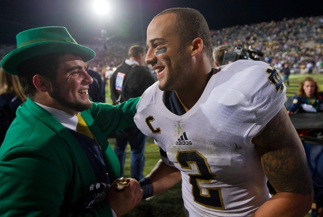 Sep 14, 2013; West Lafayette, IN, USA; Notre Dame Fighting Irish cornerback Bennett Jackson (2) celebrates with Notre Dame Leprechaun Johnny Romano after Notre Dame defeated the Purdue Boilermakers 31-24 at Ross-Ade Stadium. Mandatory Credit: Matt Cashore-USA TODAY Sports