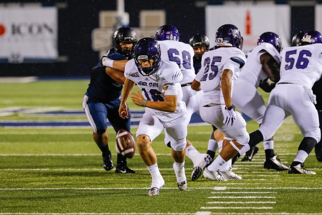 Sep 14, 2013; Logan, UT, USA; Weber State Wildcats quarterback Austin Chipoletti (16) chases down a bad snap during the 3rd quarter at Romney Stadium.  Utah State won 70-6.  Mandatory Credit: Chris Nicoll-USA TODAY Sports