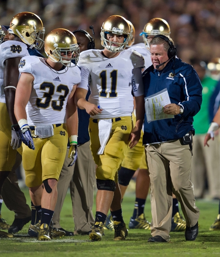 Sep 14, 2013; West Lafayette, IN, USA; Notre Dame Fighting Irish head coach Brian Kelly talks to quarterback Tommy Rees (11) and running back Cam McDaniel (33) in the third quarter against the Purdue Boilermakers at Ross-Ade Stadium. Notre Dame won 31-24. Mandatory Credit: Matt Cashore-USA TODAY Sports