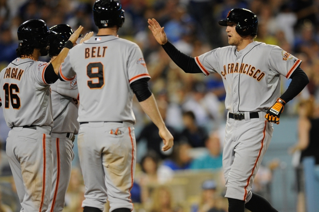 Sep 14, 2013; Los Angeles, CA, USA; San Francisco Giants right fielder Hunter Pence (8) celebrates with teammates Angel Pangan (16) and Brandon Belt (9) after hitting a grand slam against the Los Angeles Dodgers during the fifth inning at Dodger Stadium. Mandatory Credit: Kelvin Kuo-USA TODAY Sports