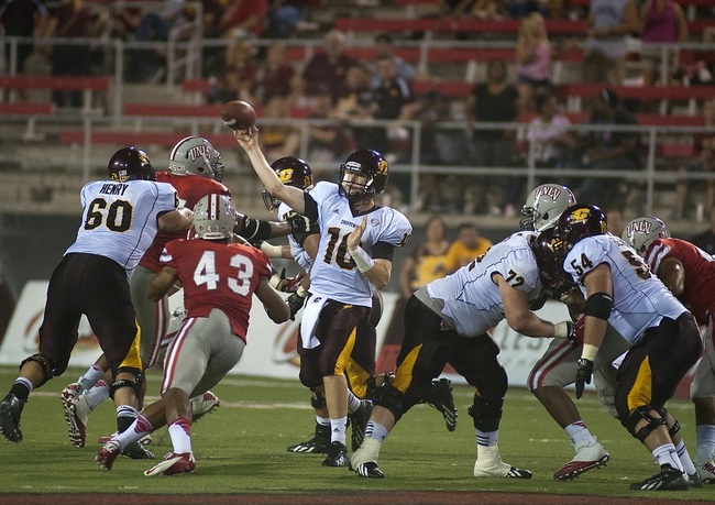 Sep 14, 2013; Las Vegas, NV, USA; Central Michigan Chippewas quarterback Cooper Rush (10)  makes a pass attempt against the UNLV Rebels during an NCAA football game at Sam Boyd Stadium. Mandatory Credit: Stephen R. Sylvanie-USA TODAY Sports