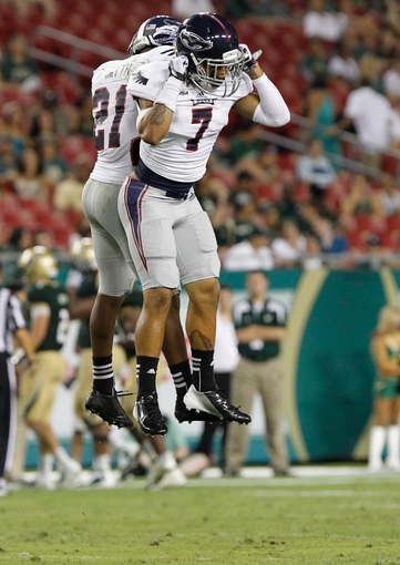 Sep 14, 2013; Tampa, FL, USA; Florida Atlantic Owls defensive back Cre'von LeBlanc (7) is congratulated by defensive back D'Joun Smith (21) after he broke up a pass against the South Florida Bulls  at Raymond James Stadium. Florida Atlantic Owls defeated the South Florida Bulls 28-10. Mandatory Credit: Kim Klement-USA TODAY Sports