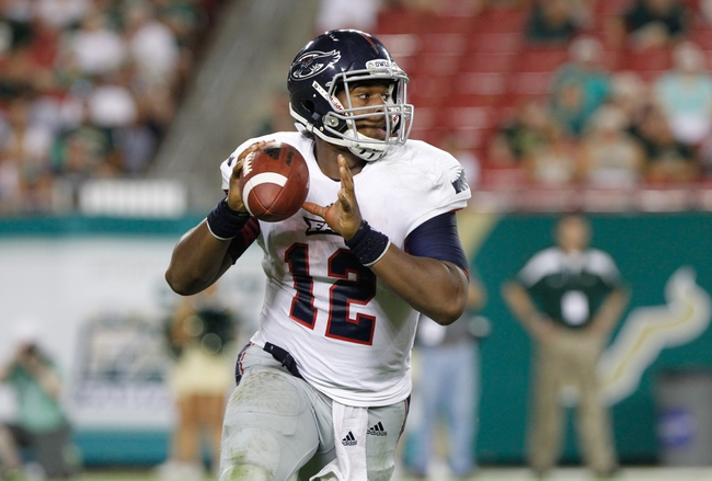 Sep 14, 2013; Tampa, FL, USA; Florida Atlantic Owls quarterback Jaquez Johnson (12) runs out of the pocket against the South Florida Bulls  at Raymond James Stadium. Florida Atlantic Owls defeated the South Florida Bulls 28-10. Mandatory Credit: Kim Klement-USA TODAY Sports