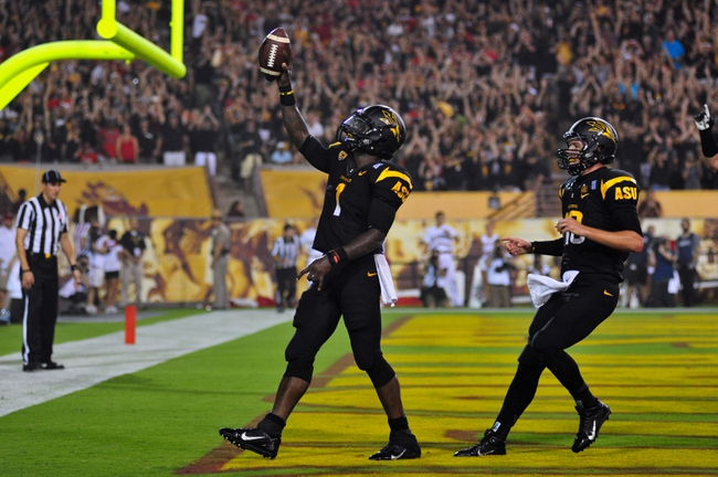 Sep 14, 2013; Tempe, AZ, USA; Arizona State Sun Devils running back Marion Grice (1) and quarterback Taylor Kelly (10) celebrate a one yard touchdown during the first half against the Wisconsin Badgers at Sun Devil Stadium. Mandatory Credit: Matt Kartozian-USA TODAY Sports
