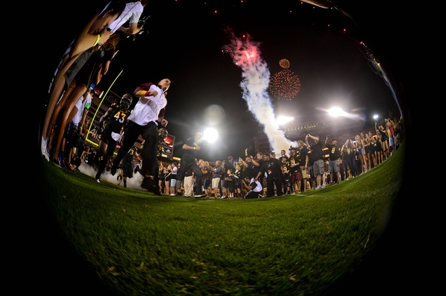 Sep 14, 2013; Tempe, AZ, USA; Arizona State Sun Devils head coach Todd Graham leads his team onto the field to start the game against the Wisconsin Badgers at Sun Devil Stadium. Mandatory Credit: Matt Kartozian-USA TODAY Sports