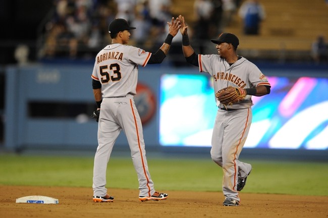 Sep 14, 2013; Los Angeles, CA, USA; The San Francisco Giants celebrate after the game against the Los Angeles Dodgers at Dodger Stadium. The San Francisco Giants defeated the Los Angeles Dodgers 19-3. Mandatory Credit: Kelvin Kuo-USA TODAY Sports
