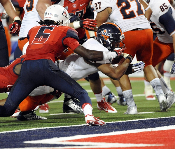 Sep 14, 2013; Tucson, AZ, USA; Texas-San Antonio Roadrunners running back David Glasco II (11) scores a touchdown during the fourth quarter against the Arizona Wildcats at Arizona Stadium. The Wildcats defeated the Roadrunners 38-13. Mandatory Credit: Casey Sapio-USA TODAY Sports
