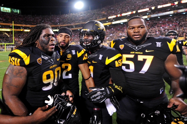 Sep 14, 2013; Tempe, AZ, USA; Arizona State Sun Devils defensive tackle Will Sutton (90), wide receiver Kevin Ozier (82), wide receiver Gary Chambers (81) and offensive linesman Evan Goodman (57) react after beating the Wisconsin Badgers 32-30  at Sun Devil Stadium. Mandatory Credit: Matt Kartozian-USA TODAY Sports