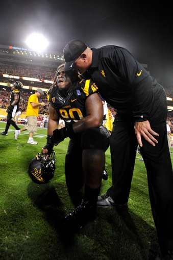 Sep 14, 2013; Tempe, AZ, USA; Arizona State Sun Devils defensive tackle Will Sutton (90) talks with a coach after beating the Wisconsin Badgers 32-30 at Sun Devil Stadium. Mandatory Credit: Matt Kartozian-USA TODAY Sports