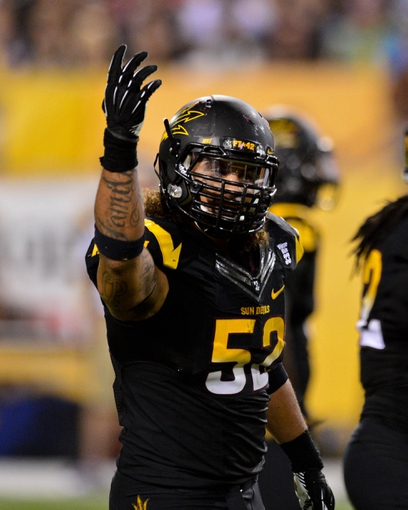 Sep 14, 2013; Tempe, AZ, USA; Arizona State Sun Devils defensive end Carl Bradford (52) signals to the crowd during the second half against the Wisconsin Badgers at Sun Devil Stadium. Mandatory Credit: Matt Kartozian-USA TODAY Sports