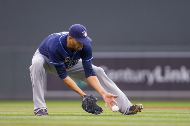 Sep 15, 2013; Minneapolis, MN, USA; The Tampa Bay Rays pitcher David Price (14) fields a ground ball in the third inning against the Minnesota Twins at Target Field. Mandatory Credit: Brad Rempel-USA TODAY Sports