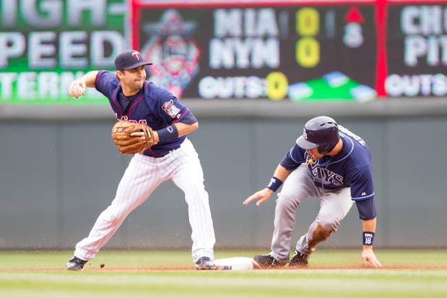 Sep 15, 2013; Minneapolis, MN, USA; The Minnesota Twins second baseman Brian Dozier (2) tries to complete the double play as Tampa Bay Rays second baseman Ben Zobrist (18) is out at second base in the fourth inning at Target Field. Mandatory Credit: Brad Rempel-USA TODAY Sports