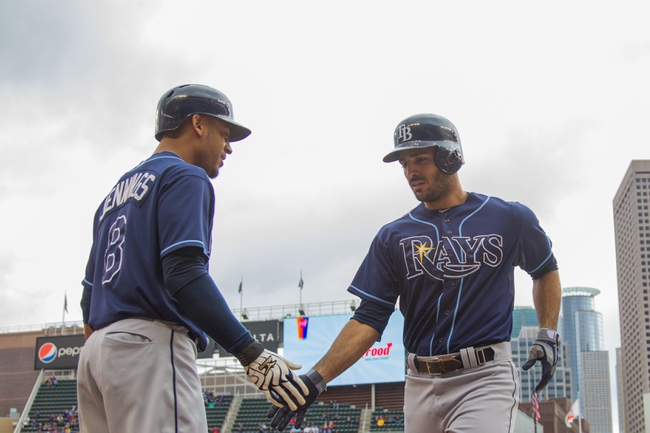 Sep 15, 2013; Minneapolis, MN, USA; The Tampa Bay Rays infielder Sean Rodriguez (1) gets congratulated by center fielder Desmond Jennings (8) after his home run in the fifth inning against the Minnesota Twins at Target Field. Mandatory Credit: Brad Rempel-USA TODAY Sports