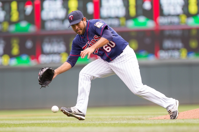 Sep 15, 2013; Minneapolis, MN, USA; The Minnesota Twins pitcher Pedro Hernandez (60) fields a ground ball in the fourth inning against the Tampa Bay Rays at Target Field. Mandatory Credit: Brad Rempel-USA TODAY Sports
