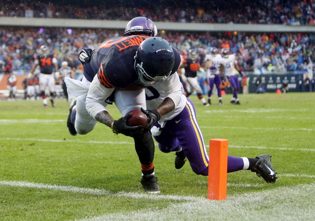 Sep 15, 2013; Chicago, IL, USA; Chicago Bears tight end Martellus Bennett (83) scores the game-winning touchdown past Minnesota Vikings cornerback Chris Cook (20) during the fourth quarter at Soldier Field. The Bears won 31-30. Mandatory Credit: Jerry Lai-USA TODAY Sports