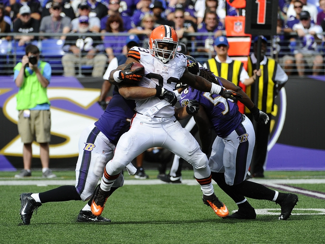 Sep 15, 2013; Baltimore, MD, USA; Cleveland Browns running back Trent Richardson (33) runs the ball against the Baltimore Ravens during the second half at M&T Bank Stadium. The Ravens won 14 - 6. Mandatory Credit: Brad Mills-USA TODAY Sports