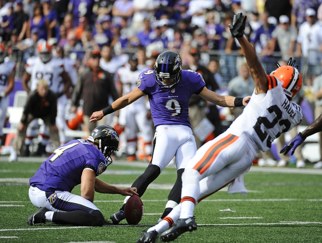 Sep 15, 2013; Baltimore, MD, USA; Baltimore Ravens placekicker Justin Tucker (9) kicks an extra point against the Cleveland Browns during the second half at M&T Bank Stadium. The Ravens won 14 - 6. Mandatory Credit: Brad Mills-USA TODAY Sports