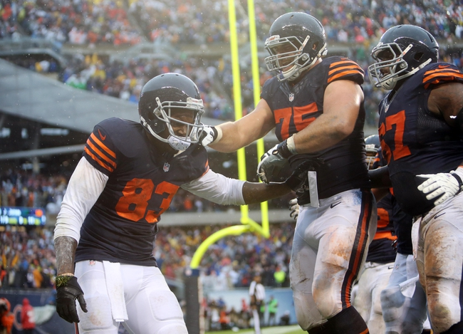 Sep 15, 2013; Chicago, IL, USA; Chicago Bears tight end Martellus Bennett (83) celebrates with offensive guard Kyle Long (75) after scoring the game-winning touchdown against the Minnesota Vikings during the fourth quarter at Soldier Field. The Bears won 31-30. Mandatory Credit: Jerry Lai-USA TODAY Sports