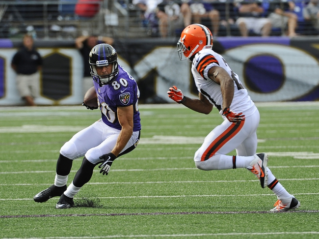 Sep 15, 2013; Baltimore, MD, USA; Baltimore Ravens wide receiver Brandon Stokley (80) runs with the ball as Cleveland Browns defensive back Chris Owens (21) defends during the second half at M&T Bank Stadium. The Ravens won 14 - 6. Mandatory Credit: Brad Mills-USA TODAY Sports